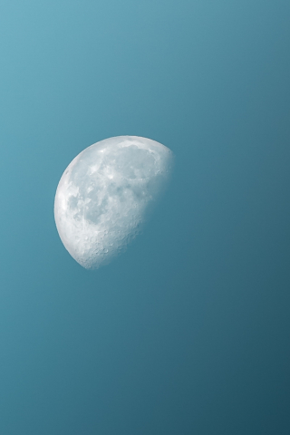 Half Moon in Blue Sky