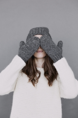 Woman hiding Her Eyes With Hands